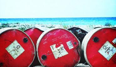 oil-barrels-coast-indonesia