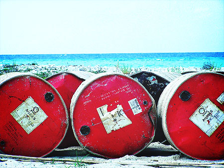 oil-barrels-coast-indonesia